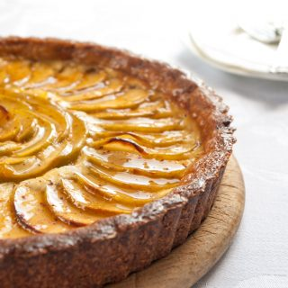 Apple Cheesecake Tart with Salted Caramel Recipe - Tart apple, creamy cheesecake filling and a salted caramel glaze, all beautifully arranged on nutty almond pastry. A luxurious dessert! By @deliciouscratch | deliciousfromscratch.com