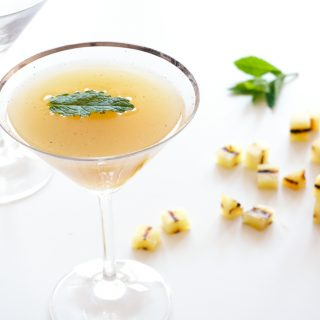 Barbecued Pineapple Mojito Royale – Charred, caramelised pineapple muddled with fresh mint, rum and raw sugar, topped up with sparkling wine. A great summer cocktail recipe. By @deliciouscratch | deliciousfromscratch.com