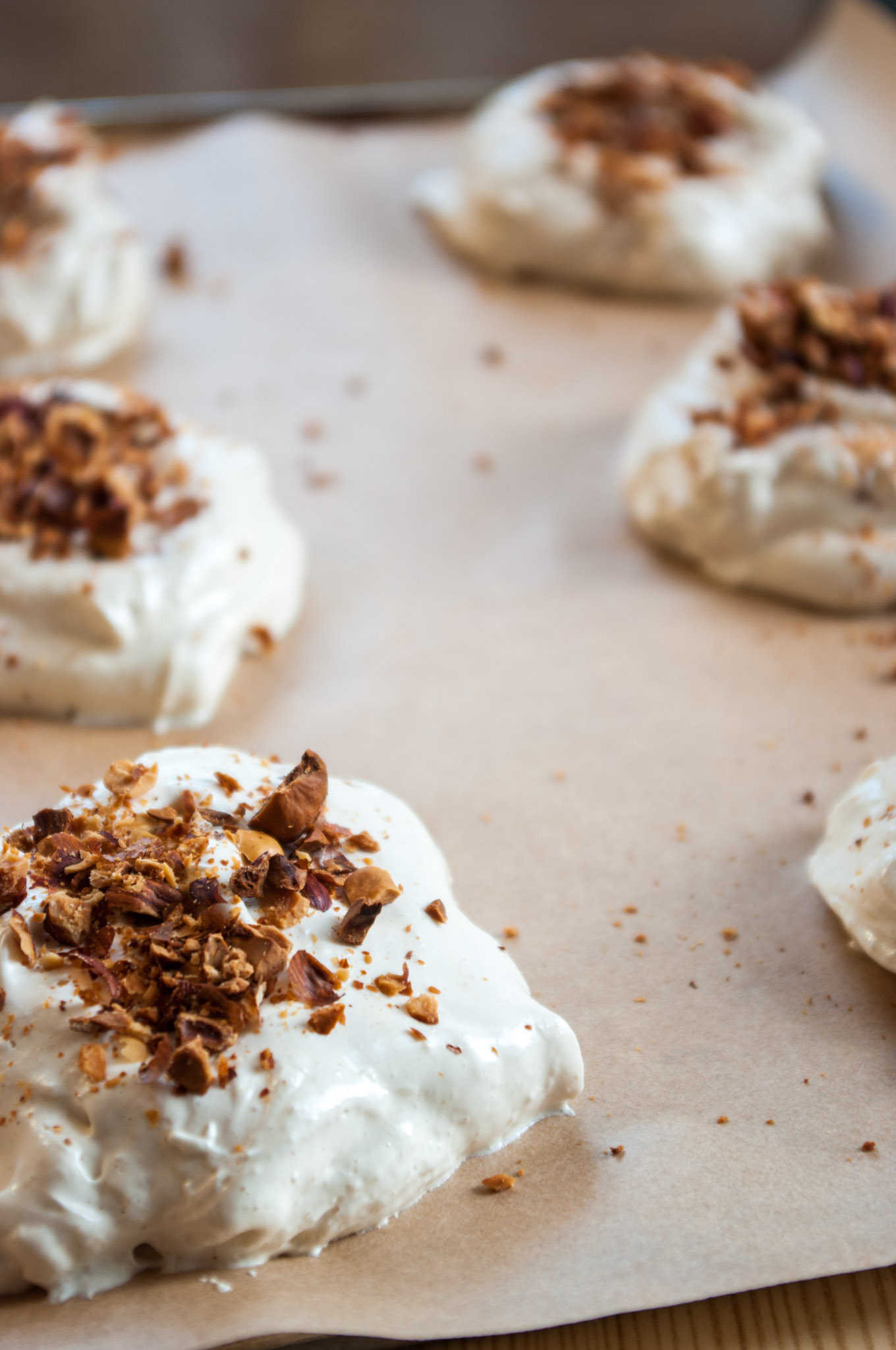 Hazelnut Meringues with Berry Sauce and Cream – Crispy, chewy, nutty meringues served with a spiced berry sauce and clouds of whipped cream. A gorgeous autumn dessert. By @deliciouscratch | deliciousfromscratch.com