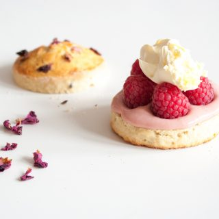 Raspberry Scones with Clotted Cream – Tender, moist, lightly sweet English scones, piled with clotted cream and tart fresh raspberries. A gorgeous summer dessert recipe. By @deliciouscratch | deliciousfromscratch.com