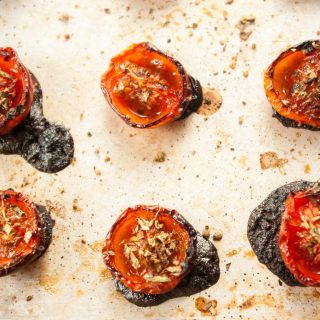 Slow-Roasted Tomatoes Recipe – Make your own oven-dried tomatoes, seasoned with fruity balsamic and fragrant oregano. A simple matter of seasoning fresh tomatoes and baking in a low oven. Healthy flavour bombs! By @deliciouscratch | deliciousfromscratch.com
