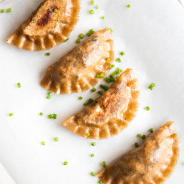 Vegan Potstickers with Tofu – Soft and crispy Chinese dumplings with an umami tofu and mushroom filling. Uses homemade wholegrain dumpling dough. This vegan gyoza recipe is super healthy and incredibly satisfying. Great vegan appetizer. By @deliciouscratch | deliciousfromscratch.com