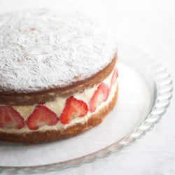 Victoria Sandwich Cake with Strawberries – A classic English cake recipe, here with whipped cream, fresh strawberries and camomile. A gorgeous summer dessert recipe. By @deliciouscratch | deliciousfromscratch.com