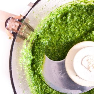 Wild Garlic Pesto – A homemade pesto recipe made with lemon and wild garlic, which grows in parks and woods all around us in spring. An easy recipe using wild greens. Great as a dressing for roasted vegetables, stirred through risotto and polenta or as a  vegetarian pasta sauce. By @deliciouscratch | deliciousfromscratch.com