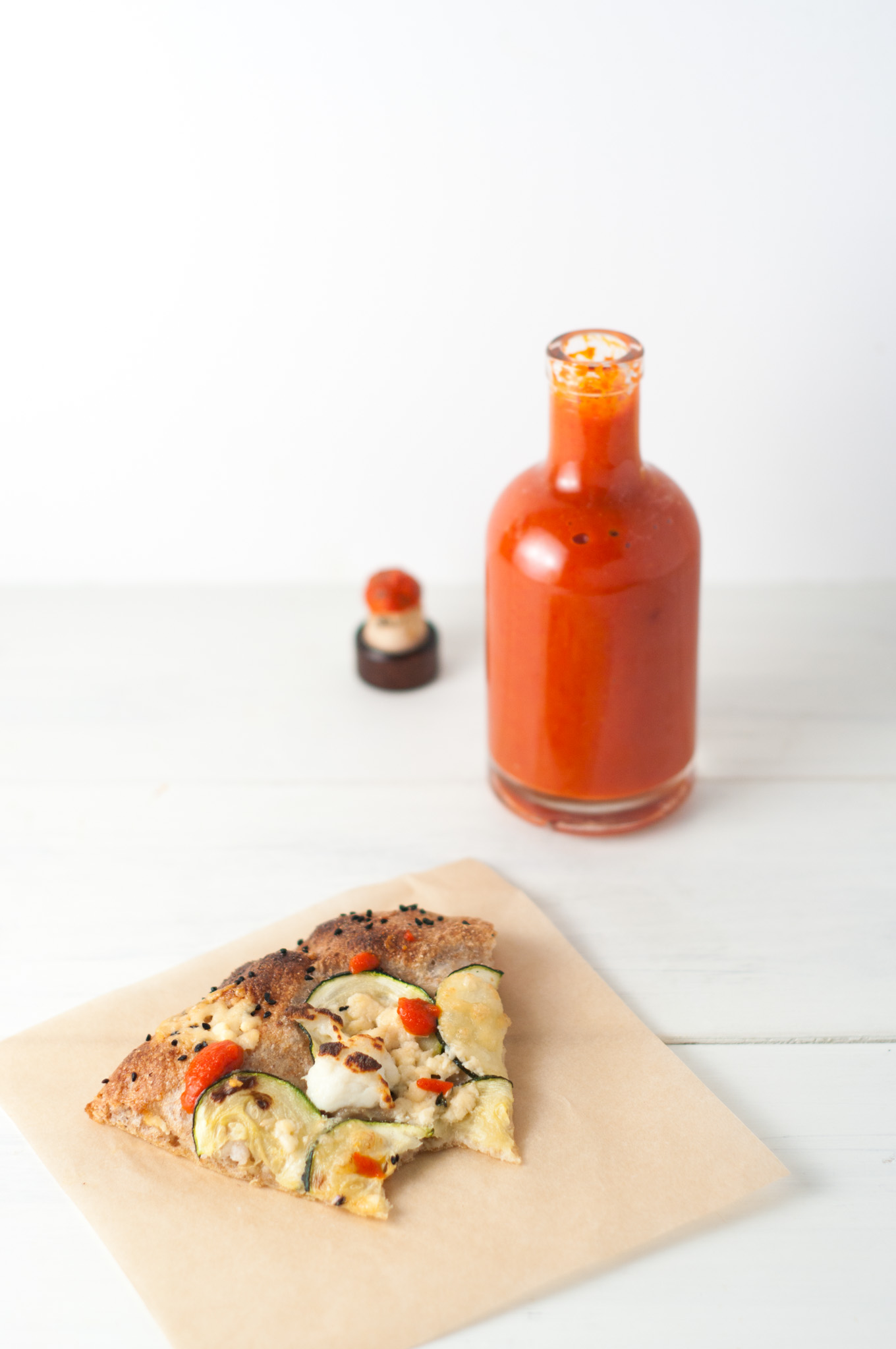 Homemade Chilli Sauce - This homemade sriracha recipe blends plenty of hot red chillies and garlic with a touch of sugar, salt and vinegar for a sweet, tart, spicy taste sensation! By @deliciouscratch   familycuisine.net