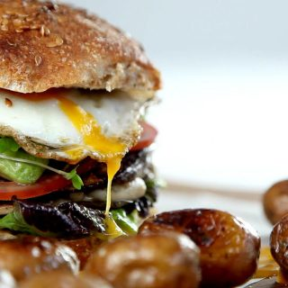 Ultimate veggie burger recipe – the best vegetarian burgers, piled with all kinds of vegetables, melty cheese and tangy seasonings. And a crispy fried egg. And roasted new potatoes. Vegetarian nom.