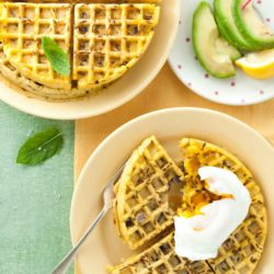 Halloumi onion bhaji waffles recipe from How to Cook Halloumi cookbook by Nancy Anne Harbord. Super easy breakfast waffles with chickpea flour, fresh onion and cumin. Serve with poached eggs and avocado for a healthy brunch. By @deliciouscratch | deliciousfromscratch.com