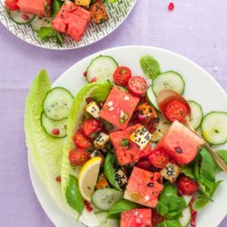 Halloumi watermelon salad recipe from How to Cook Halloumi cookbook by Nancy Anne Harbord. Toasted halloumi coated in seeds with pomegranate, mint and tomato. A bright, halthy halloumi salad absolutely packed with flavour. By @deliciouscratch   deliciousfromscratch.com