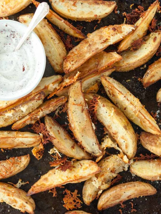 Caramelised halloumi potato wedges from How to Cook Halloumi cookbook by Nancy Anne Harbord. Baked potato wedges with crispy halloumi coating and sumac yoghurt dip. By @deliciouscratch | deliciousfromscratch.com
