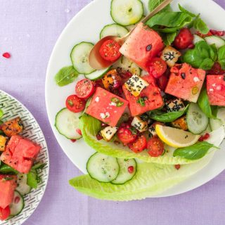 Halloumi watermelon salad recipe from How to Cook Halloumi cookbook by Nancy Anne Harbord. Toasted halloumi coated in seeds with pomegranate, mint and tomato. A bright, halthy halloumi salad absolutely packed with flavour. By @deliciouscratch | deliciousfromscratch.com