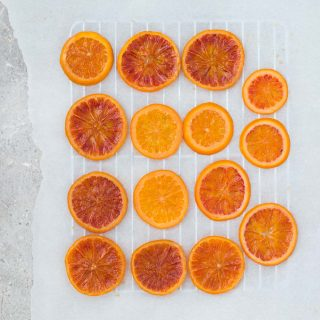 Candied blood orange slices recipe – a beautiful garnish for cakes and desserts.