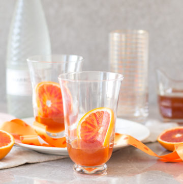 Blood orangeade recipe – an incredibly flavoured orange syrup, topped up with sparkling water. A lovely spring and summer drink.
